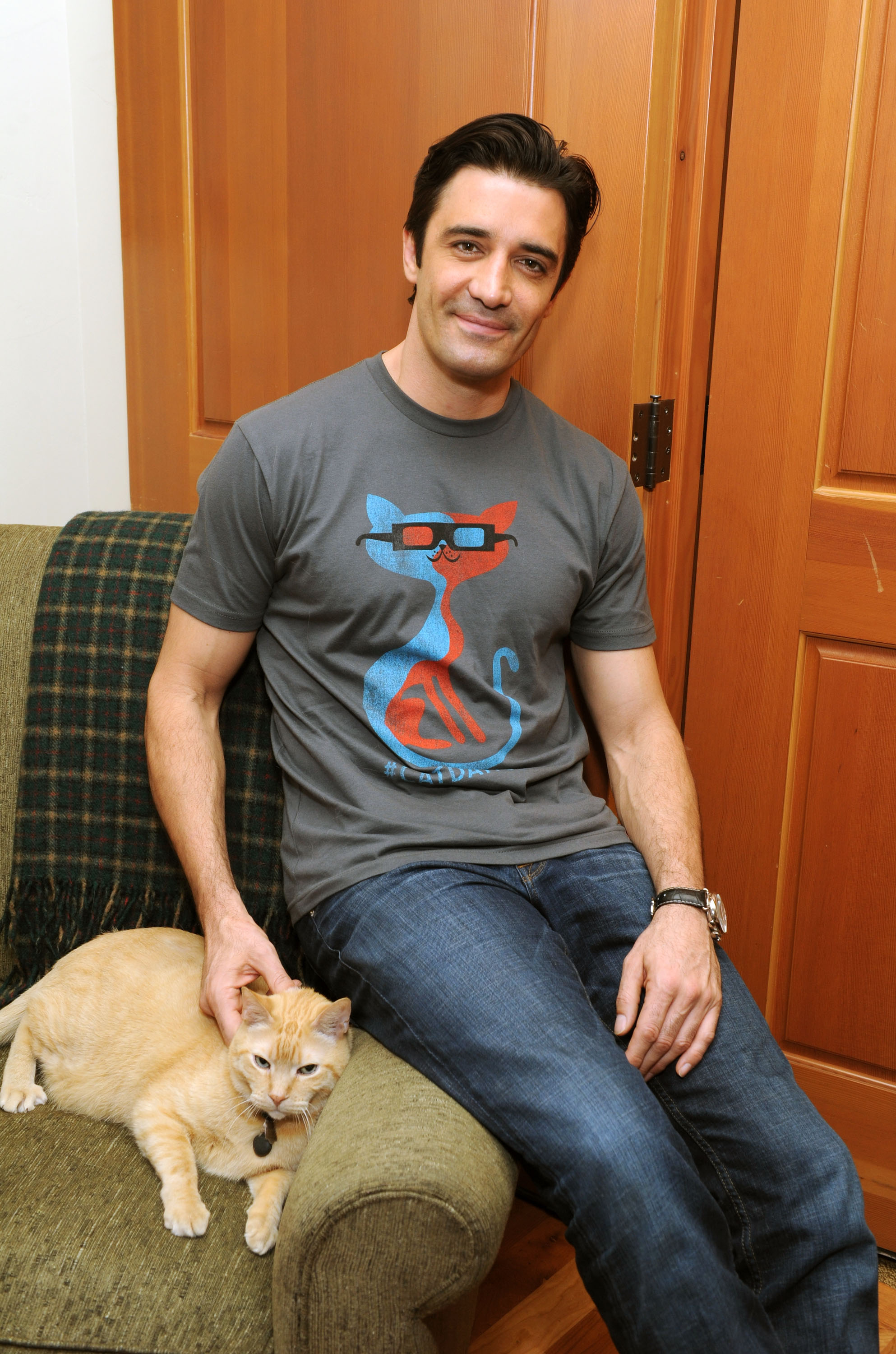 Gilles Marini with his beloved cat. (Photo credit Craig Barrit/Getty Images for GenArt)