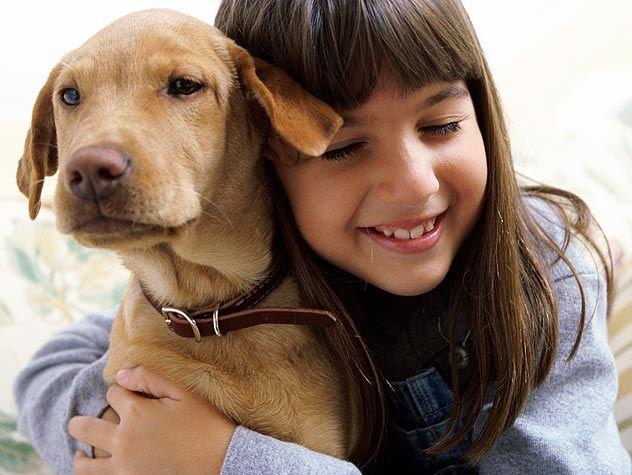 kid hugging dog